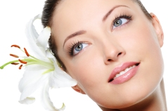 Healthy Skin Of Beautiful Woman Face With A Flower